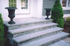 Concrete front steps with stone veneer