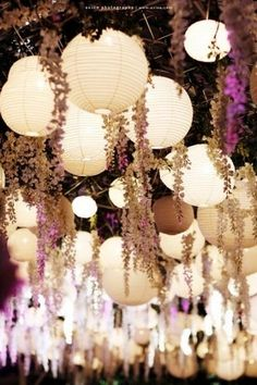 21 DIY hanging decor ideas for an outdoors wedding. Everything from paper pom poms to glass jars. Something for every style.