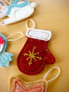 I've joined in Homemade by Jill 's advent calendar sew-a-long , and I just finished my first set of 8 ornaments! These have been such f...
