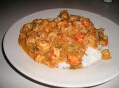 Crawfish or Shrimp Etoufee  1 stkbutter  1 Tbsp flour  3 Tbsp bell pepper, chopped  1 lg onion, chopped  2 clove garlic, minced  1 can(s) cream of celery soup  1 tspsalt  1 tspblack pepper  1/2 c green onion, chopped  1 tspparsley  1 lbcrawfish tails or cooked shrimp  dash(es) paprika  pinch of red pepper flakes to taste