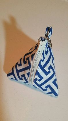 Check out this item in my Etsy shop https://www.etsy.com/listing/249044042/blue-labyrinth-triangle-pacifier-zipper