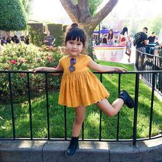 Because @disneyland is the happiest place on earth!! #babyzooey Dress: @marinandmorgan Bloomers : @ultravioletkids Boots: @drmartensofficial Sunnies: @wearesonsanddaughters