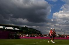 LONDON, ENGLAND - JULY 28: Mike Bryan and Bob Bryan of the United States play against Andre Sa and Thomaz Bellucci of Brazil during their Men's Doubles Tennis match on Day 1 of the London 2012 Olympic Games at the All England Lawn Tennis and Croquet Club in Wimbledon on July 28, 2012 in London, England. (Photo by Phil Walter/Getty Images)