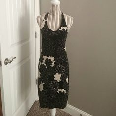Mossimo Mod Print Halter Dress Adorable halter dress by Mossimo...it is a black and cream mod print, hits at knee and ties at neck.  The dress has built-in support for the top (see third pic) and is unlined...dress has been worn only a handful of times, in great condition!  (PRICE FIRM, UNLESS BUNDLED). Mossimo Dresses Backless