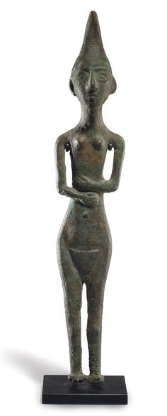A CANAANITE BRONZE FEMALE DEITY -  CIRCA FIRST HALF OF THE 2ND MILLENNIUM B.C.   | Christie's