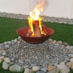 Gina of Kleinworth and Co. is the wife of a fire chief, so when she described the process of building her backyard fire pit, we paid close attention! To start, never place a store-bought fire pit directly on your lawn or your wood deck. Gina centered hers atop a circle of rocks with weed barrier fabric beneath it.
