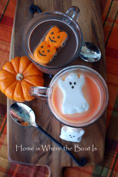 Halloween Orange Hot Cocoa - White hot cocoa with food coloring and a ghost peep.