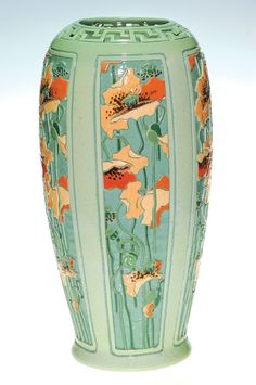 """Rare and important Roseville Della Robbia vase carved and painted by Golde Barnell. The vase contains five panels, each with yellow and orange poppies running vertically from base to reticulated rim. A total of seven colors were used in the decoration and of course, the carving is deep and intricate. The vase is marked with a Rozane Ware wafer seal and signed """"Golde"""" on the side."""
