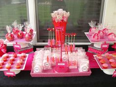 Red and pink themed party with a layered but straight forward table design