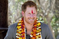 Prince Harry is given a Topi, a traditional Nepalese hat, at Danna homestay village