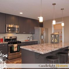 We can't get enough of the dark gray cabinets in this kitchen! Can you say low maintenance?  Candlelight Homes. Utah Homes. Utah Builder. New Homes Utah. We Build Beautiful. Home Decor. Interior Design. Cabinets. Gray Cabinets. Granite Countertops. Home. Utah.