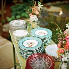 Vintage Wedding China | Inspired by her grandmother's love of china, the bride decided to serve dinner on mixed china patterns. Instead of renting so many different sets, she and her mom scoured thrift shops, flea markets, and antiques stores to collect enough to serve all 275 guests. | http://SouthernLiving.com