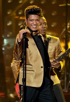 Bruno Mars and his band wore Dolce & Gabbana to perform at the 54th Grammy Awards in Los Angeles