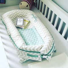 """No wonder babies have a hard time sleeping in big cribs after being surrounded and snug in the womb. Our crib insert baby pods make babies feel instantly at """"home."""" #sleepyheadofsweden @waceystyle"""