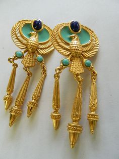 """Elizabeth Taylor """"Cleopatra"""" earrings...turquoise enameling with falcon bird made by Avon"""