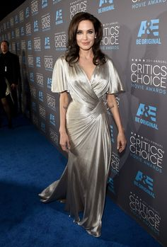Pin for Later: 17 Unforgettable Looks From the 2015 Critics' Choice Awards Angelina Jolie Angelina shimmered in a sexy silver Atelier Versace gown.