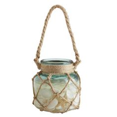 Our LED has everything but the beach. A nifty rope wraps its way around the glass jar, creating a net-like structure all the way to the top, then it forms a handy handle above. Natural seashells fill the inside, leaving just enough room for flameless candlelight to glow. Throw in the sounds of waves crashing and you'll swear you're seaside.