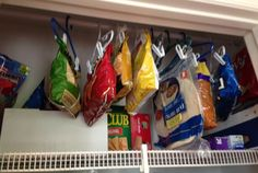 Organize your pantry! No more broken chips, no more buried bags and you free up a pantry shelf! You can use kid sized pant hangers as chip clips and then hang Great use for some of those pant hangers Kitchen Organization Pantry, Kitchen Pantry, Kitchen Hacks, Storage Organization, Food Storage, Storage Ideas, Pantry Ideas, Storage Shelving, Household Organization