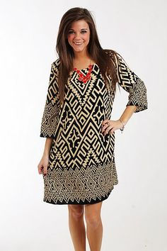 """The Cleo Dress, Black $41.00  If you've been searching for a dress that's easy to throw on but has plenty of style, this is it! The black and cream piece has a shift style and bell sleeves, and the different sizes of tribal patterns are a great touch. Just add boots or flats!   Fits true to size. Miranda is wearing a small.   From shoulder to hem:  Small - 34""""  Medium - 35""""  Large - 36"""""""