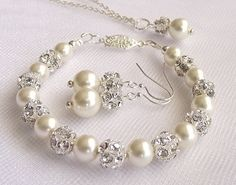 This listing is for 1(one) earrings, necklace and bracelet Set! This beautiful wedding set is made of ivory-cream Swarovski pearls accented with silver rhinestone beads (fireballs) with lots of luster and sparkle! The bracelet is 7.6 long and closes with a silver plated vintage inspired push-in clasp. The necklace chain is sterling silver plated and measures 18. Earrings length is approx. 1.6 / 4cm including the sterling silver plated ear hooks. A wonderful jewelry for your special day...