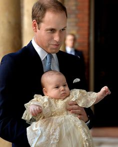 Prince William, Duke of Cambridge arrives, holding his son Prince George, at Chapel Royal in St James's Palace, ahead of the christening of ...
