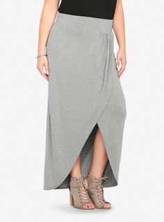 Soft and simple, this heather grey tulip maxi skirt delivers effortless drape with side shirring and a crossover front design. Made from comfy jersey knit, the sexy skirt has an elongated elastic waistband that is designed for a flattering fit.