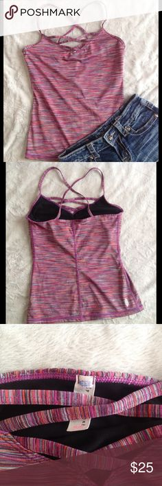 Free People FP Movement Garland Tank Space Dyed Excellent used condition. Fun and functional space dye workout tank with crisscross back straps and strappy detailed neckline. 94% polyester, 6% spandex. Built-in breathable Power Mesh shelf bra. Free People Tops
