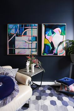 dark, moody, monochromatic living space // abstract artwork // geometric rug