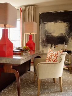 restrained pop of bright color in drapery banding, lamps and pillow. curved lampshades, lacquered parchment?