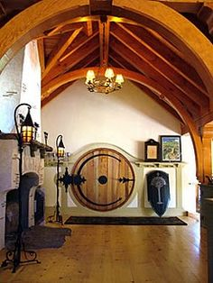Extremely beautiful must see stone cottage hobbit guest house. Rickety hobbit fencing, interior built to look like J. Tolkien hobbit house and more. Home Design, Cabin Design, Cottage Design, Design Ideas, Hobbit House Interior, Sweet Home, Round Door, House Front, The Hobbit