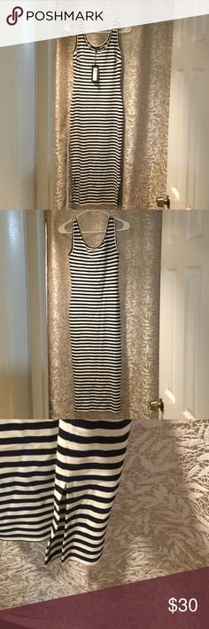 Black and white midi dress Brand new with tags midi dress.  Eur size 6 fits like a 2 Marks and Spencer Dresses Midi