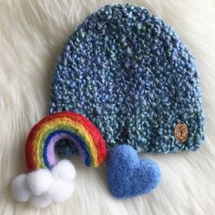 Rainbow Baby Needle Felted Newborn Photography Wool Prop When you need a little Hope, make your own Rainbow☁️ One of my favorite set of Wool Props I have made yet and I love how they look with the Newborn hat I knitted! Watch me make this Rainbow in my latest You Tube video, link is in below!