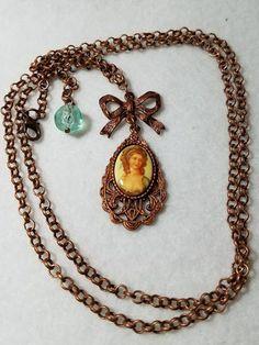 Vintage cameo bonded to Gingerbread Pewter frame