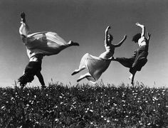 Three girls dancing in Springtime.