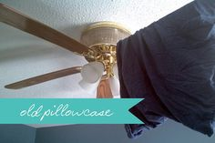 Throw an old pillowcase around the fan blades and wipe from within. It should keep all the dust inside and be wayyy easy.