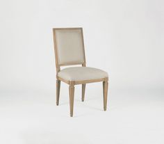 This square back dining chair with a customizable finish over oak is sure to complement dining tables.