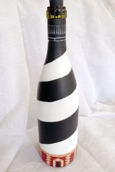 I thight this was well done. I wonder if any have been sold? Wine Bottle Lighthouse Cape Hatteras by CreativeChameleon on Etsy, Glass Bottle Crafts, Wine Bottle Art, Painted Wine Bottles, Diy Bottle, Painted Wine Glasses, Wine Bottle Tiki Torch, Empty Bottles, Glass Bottles, Wine Craft
