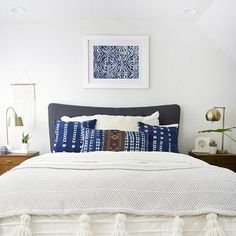 Create this DIY Large Scale Stencil Art overtop of an abstract painting to create the perfect over the bed art for your room!