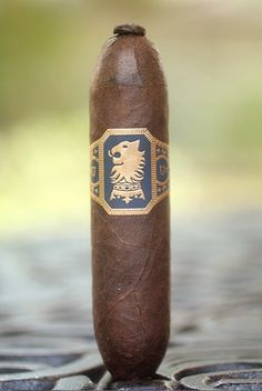 It may be short, but it still packs the punch. It is a tad bit expensive for the time that you get out of it, but I would recommend it to those who enjoy a darker cigar. Man Smoking, Cigar Smoking, Smoking Pipes, Good Cigars, Cigars And Whiskey, Drew Estate, Cigar Art, Premium Cigars, Cigar Lighters
