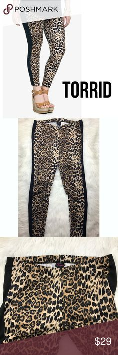 "Torrid Stretch Leopard Leggings Pants 2X Super sexy stretch leopard leggings from Torrid. EUC.  Has black panel on the leg to make your legs look longer and thinner.  Torrid size 2 = 2X Approximate measurements lying flat: Waist 18"" Rise 9"" Inseam 30"" B15 torrid Pants Leggings"