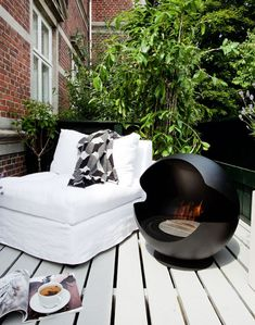 Indoor Outdoor BioEthanol Fireplace by Vauni | The lovely Globe bio ethanol fireplace by Vauni is meant to be enjoyed all year round, inside or out. Whether free standing or elevated by a foot, this fireplace can be easily rotated 360 degrees for optimal enjoyment. Globe is designed by Markus Grip and is available in two variations; cast iron with a matt finish or polished black granite. |