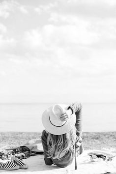 Girl sunbathing in a sun hat http://www.styledamerican.com