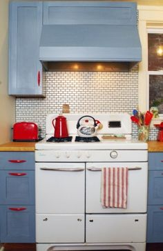 love this red & blue kitchen with the vintage stove. by liza