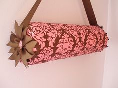 Headband holder diy: roll of paper towels, fabric, ribbon, & hot glue.