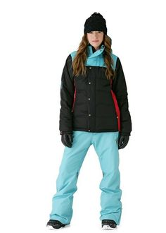 Alexandra Jean is wearing a black with turquoise shoulders & red torsos of her hunter's style ski jacket.