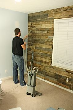 "DIY: Accent wall out of wood pallets. 1st hang Plywood. Find untreated wooden pallets (2 doz). Cut through nails & disassemble. Sand splinters and dirt. Clean. Sort by width, then condition. Use 1"" nails & nailgun. Will need saw for cut arounds. Once done, vaccum and apply atan polyurethan. I'm thinking this would make a fabulous headboard!  I still want to do this in my son's room."