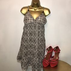 L.e.i. Dress Size XL with elastic in the back area, and cups for shape in the chest. Cute beads on the straps and tie in the back with lace trim on bottom. lei Dresses