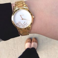 """Gold Rakani Watch Gold Rakani watch with """"fallen"""" numbers on the face. Barely worn, in excellent condition! Rakani Accessories Watches"""