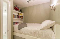 Bed built into a studio walk in closet.  Cute