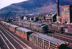 Pennsylvania Railroad Trains passing through East Conemaugh Borough, Cambria County. Diesel Locomotive, Steam Locomotive, Pennsylvania Railroad, Rail Car, Train Engines, Rolling Stock, Train Travel, Travel Posters, Railroad Tracks